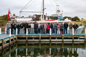 Community members and EGCMA staff stand in front of the Lady Jane boat moored on the Nicholson River in East Gippsland.